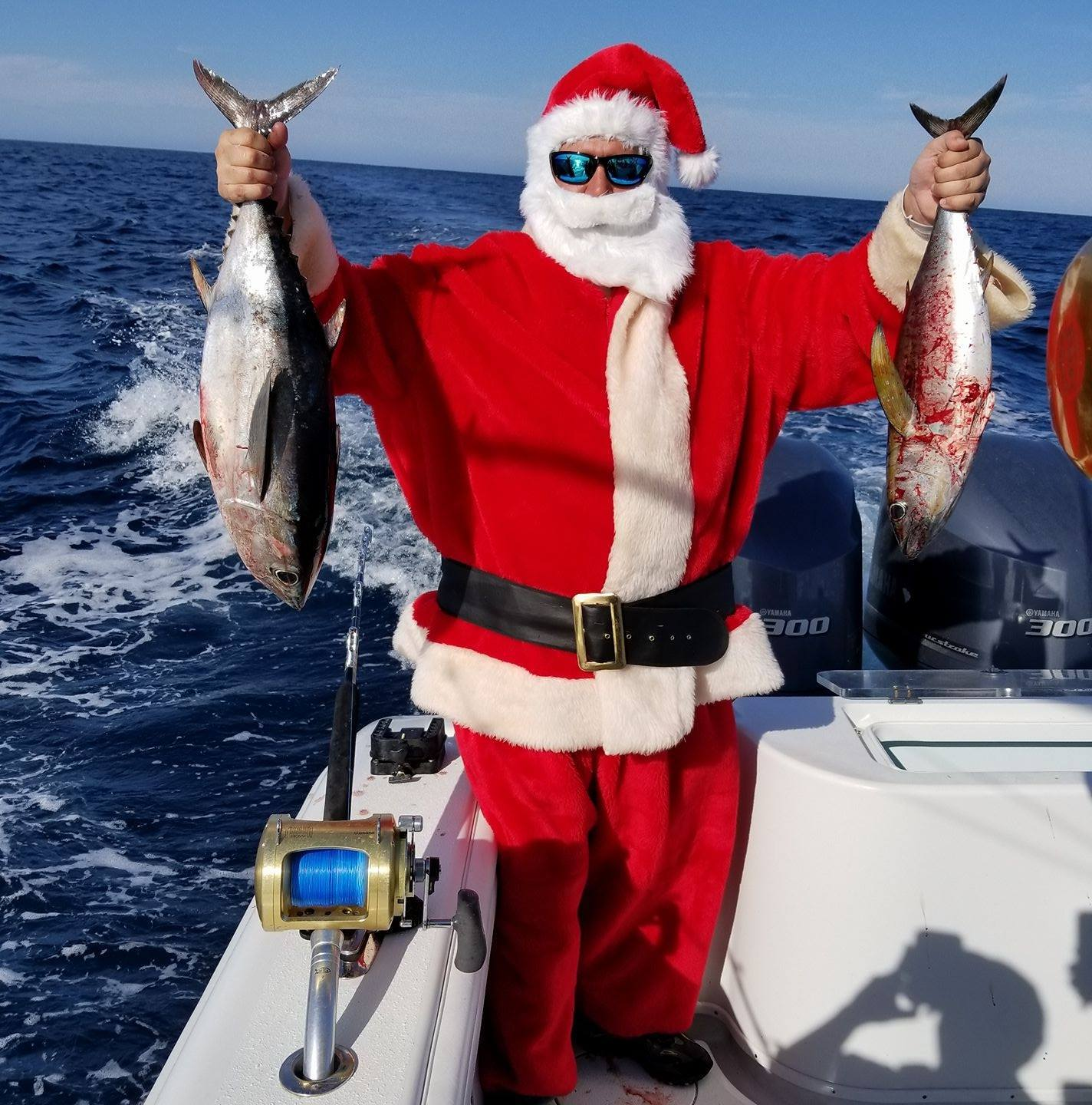 santa fishing on a boat shirt